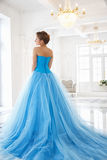 Beautiful bride in gorgeous blue dress Cinderella style stock image