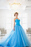 Beautiful bride in gorgeous blue dress Cinderella style royalty free stock images