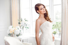 Beautiful bride in gorgeous wedding dress indoors. Wedding fashion Stock Photos