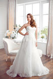 Beautiful bride in gorgeous wedding dress indoors. Wedding fashion Stock Photos