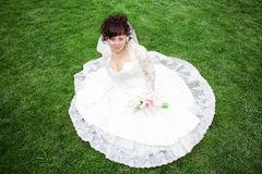 A beautiful bride on a green meadow Stock Photo
