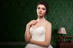Beautiful bride on green vintage pattern background Royalty Free Stock Images