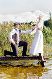 Beautiful bride and groom on the bridge Stock Photography