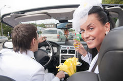 Beautiful bride and groom in cabrio Stock Photo