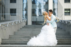 Beautiful bride and groom in the city Stock Photo