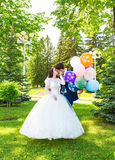 Beautiful bride and groom  with colorful balloons Royalty Free Stock Photography