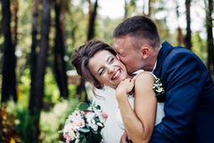 The beautiful bride and groom. Cool bride and groom hugging and laughing Royalty Free Stock Photography