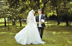 Beautiful bride and groom dancing outside Stock Photography