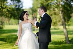 Beautiful bride and groom. Eating candy Royalty Free Stock Images