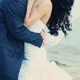 Beautiful bride and groom embracing. Stock Photo