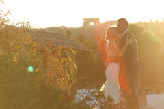 Beautiful bride and groom embracing at dusk Royalty Free Stock Photo
