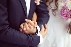 Beautiful bride and groom. Bride and groom holding hands Royalty Free Stock Photo