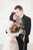 Beautiful Bride and Groom Hugging. Fashion Model Woman Stock Photo