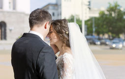 Beautiful bride and groom hugging outdoor Stock Photography