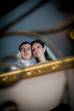 Beautiful bride and groom in indoor setting Royalty Free Stock Photography