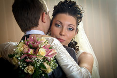 Beautiful bride and groom in indoor setting Royalty Free Stock Photo