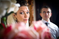 Beautiful bride and groom in indoor setting Stock Image