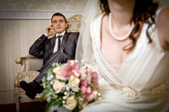 Beautiful bride and groom in indoor setting Royalty Free Stock Image