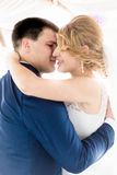 Beautiful bride and groom kissing at first dance Stock Photo