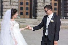 Beautiful bride and groom laughing  outdoor Royalty Free Stock Photos