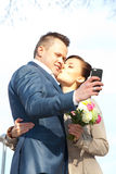 Beautiful bride and groom make selfie Stock Images
