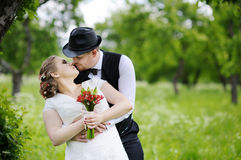 Beautiful bride and groom. In a park Stock Images