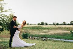 Beautiful bride and groom in a park. Royalty Free Stock Image