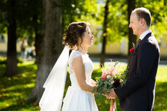 Beautiful bride and groom in the park on a sunny day Royalty Free Stock Photo