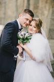 Beautiful bride and groom posing in a yard of a castle Stock Photos