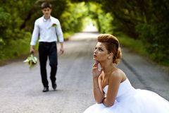 Beautiful bride and groom, the road auto-stop Stock Image