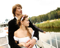 Beautiful bride and groom on a ship Royalty Free Stock Images