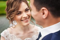 Beautiful bride and groom smiling in nature near the lake Stock Photos
