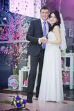 Beautiful bride and groom standing in a shop Stock Photo