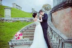 Beautiful bride and groom stay on stairs Royalty Free Stock Images