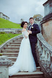 Beautiful bride and groom stay on stairs Stock Photo