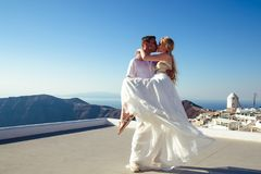 Beautiful bride and groom in their summer wedding day on greek island Santorini royalty free stock photos