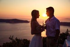 Beautiful bride and groom in their summer wedding day on greek island Santorini Stock Photo