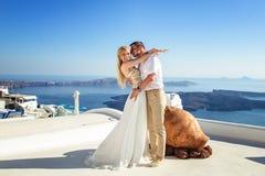 Beautiful bride and groom in their summer wedding day on greek island Santorini Royalty Free Stock Photography