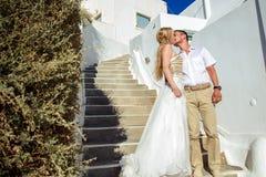 Beautiful bride and groom in their summer wedding day on greek island Santorini Royalty Free Stock Photo