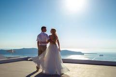 Beautiful bride and groom in their summer wedding day on greek island Santorini Stock Photography