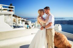 Beautiful bride and groom in their summer wedding day on greek island Santorini Stock Photos
