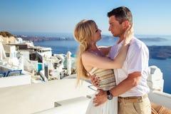 Beautiful bride and groom in their summer wedding day on greek island Santorini Royalty Free Stock Photos