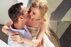Beautiful bride and groom in their summer wedding day on greek island Santorini Stock Image