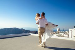 Beautiful bride and groom in their summer wedding day on greek island Santorini. Honeymoon travel royalty free stock photos