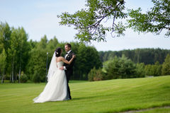 Beautiful bride and groom. By a tree Stock Photos