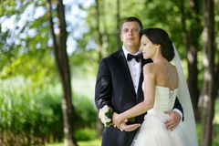 Beautiful bride and groom. By a tree Stock Photo