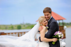 Beautiful bride and groom on a walk in the park Stock Images