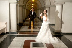 A beautiful bride and handsome groom at Christian church during wedding. Stock Image