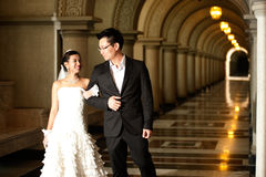 A beautiful bride and handsome groom at Christian church during wedding. Stock Photos