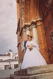 A beautiful bride and handsome groom at church during wedding Royalty Free Stock Photo